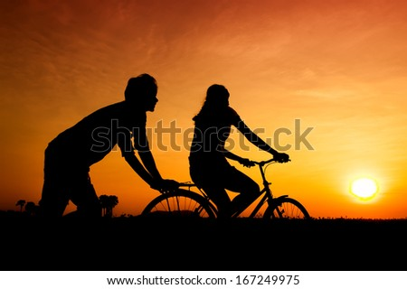 Silhouettes of happy couple
