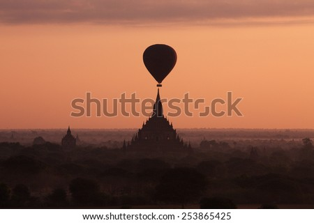 Silhouettes of hot air balloon and ancient Sulamani temple at amazing sunrise. Buddhist Temple at Bagan Kingdom, Myanmar (Burma). - stock photo