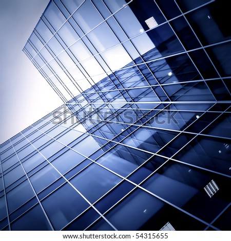 silhouettes of modern glass skyscrapers at night - stock photo