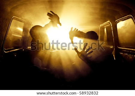 silhouettes of passengers in the car full of smoke - stock photo
