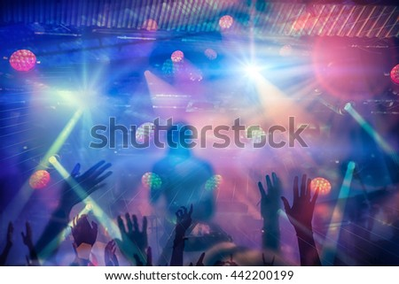 Silhouettes of people and musicians in big concert stage - stock photo