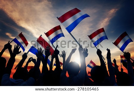 Silhouettes of People Holding Flag of Netherlands