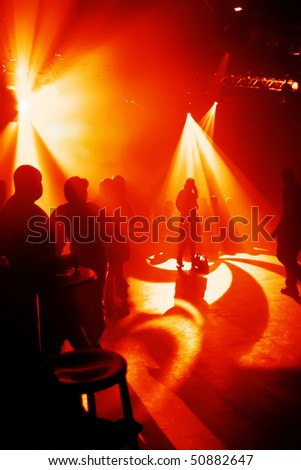 silhouettes of people in a disco - stock photo
