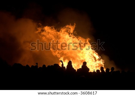 silhouettes of people over bonfire, Spain