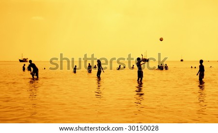 silhouettes of people playing games in the sea full of sailing-ship