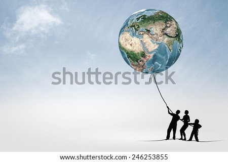Silhouettes of people pulling Earth plane with rope. Elements of this image are furnished by NASA - stock photo