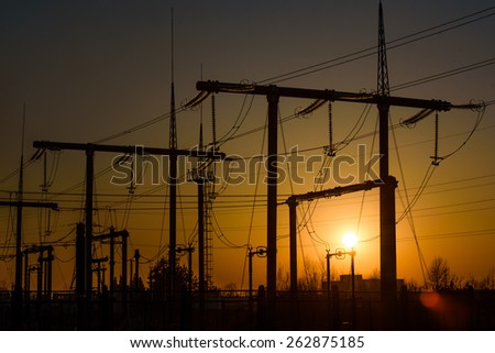silhouettes of power towers - stock photo
