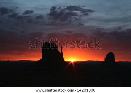 Silhouettes of rocks from the famous Navajo Tribal Park-Monument Valley. Arizona. USA - stock photo