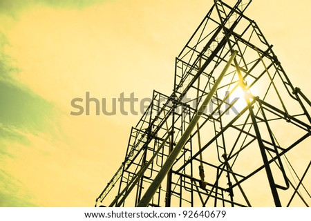 Silhouettes of scaffolding on sunset - stock photo