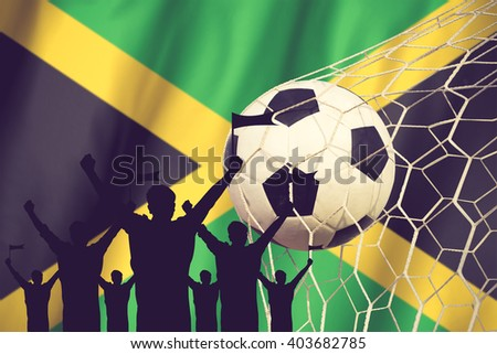 silhouettes of Soccer fans with flag of Jamaica .Cheer Concept vintage color - stock photo