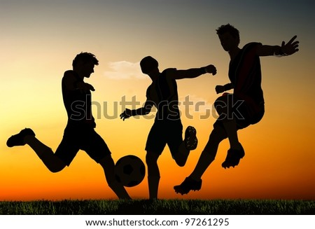 Silhouettes of soccer players.