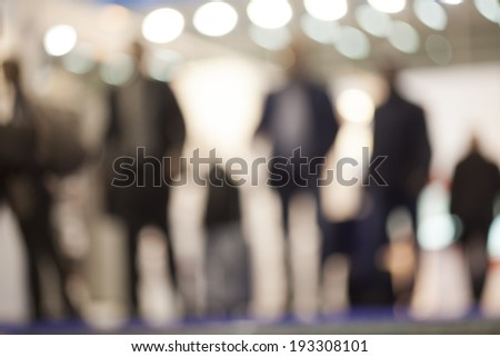 Silhouettes of the busy people - stock photo