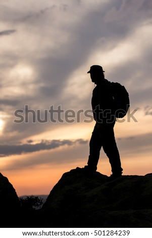 Silhouettes of the climber at sunset.Sport and active life.