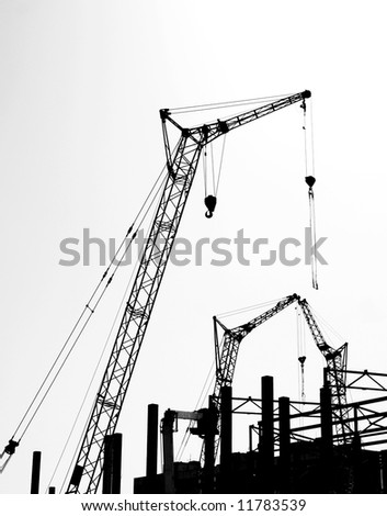 Silhouettes of the construction 2. Black and white photo. - stock photo