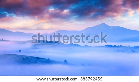 Silhouettes of the mountain hills in the morning mist. Colorful summer scene in Carpathians. Mt. Petros,  Transcarpathians, Ukraine, Europe. - stock photo