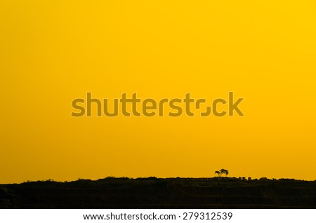 Silhouettes of trees on a ridge alone Mae Moh coal mine in Lampang, Minimalism. - stock photo
