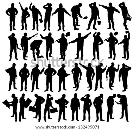 silhouettes of workers - stock photo