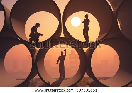 Silhouettes of workers in the pipes. - stock photo