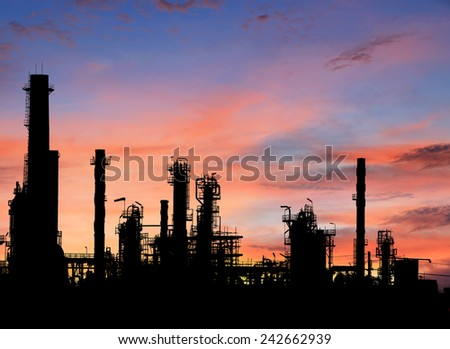 Silhouettes Oil refinery at sunrise - stock photo