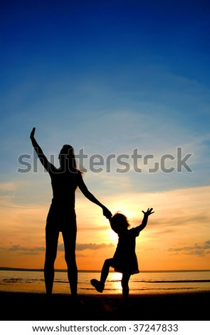 Silhouettes on sundown - stock photo