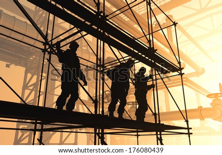 Silhouettes on the background of the plant workers. - stock photo
