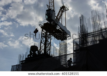 Silhouettes workers with construction & blue sky background