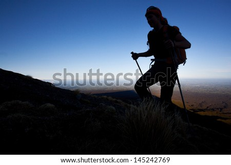 Silhoutte of a mountain hiker - stock photo