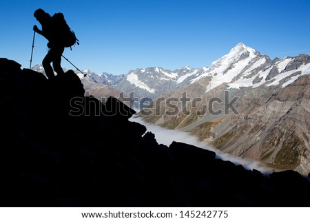 Silhoutte of a mountaineer in the Alps - stock photo