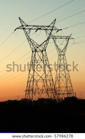 Silhoutte of Electrical Pylon - stock photo