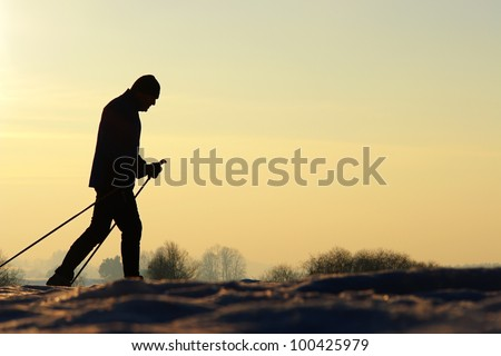 Silhoutte of people doing wintersport............ - stock photo
