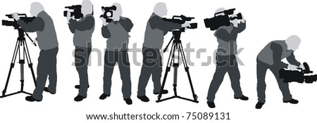 silhouttes of cameramen - stock photo