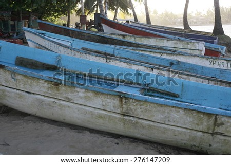 silhuete of a fishing boats  on the beach  , life on the beach