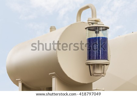 Silica gel breather attach to the conservator tank of oil immersed transformer