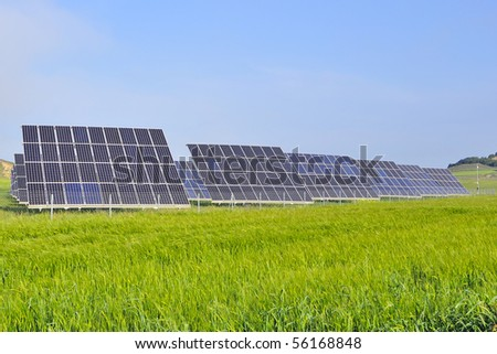 silicon solar energy batteries on green meadow - stock photo