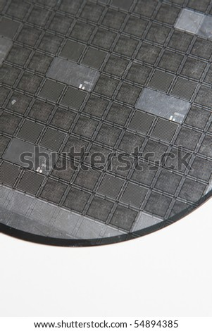 Silicon wafer on a white background - stock photo
