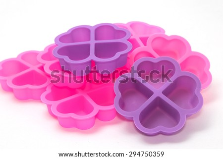 silicone baking cups , silicon cupcake tin isolated white background