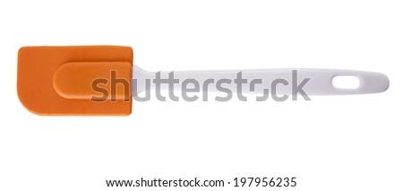 Silicone kitchen spatula on a white background - stock photo