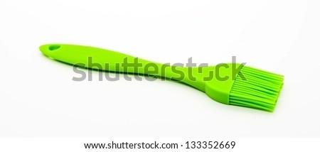 Silicone pastry brush isolated on white - stock photo