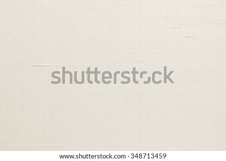 Silk fabric wallpaper texture pattern background in light cream beige gold color tone: Fine natural raw Thai silk detail textured organic fiber textile backdrop in creme white toned colour  - stock photo