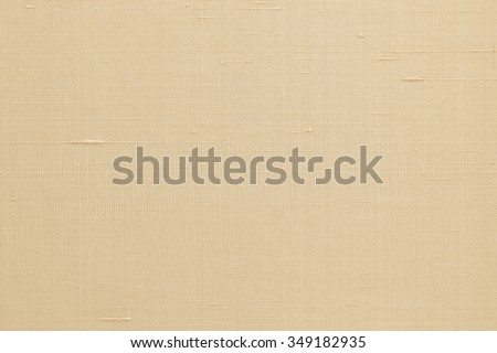 Silk fabric wallpaper texture pattern background in light yellow cream beige gold color tone: Fine natural raw Thai silk detail textured organic fiber textile backdrop in golden toned colour  - stock photo