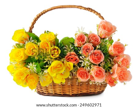 silk flowers in a basket isolated on white background - stock photo