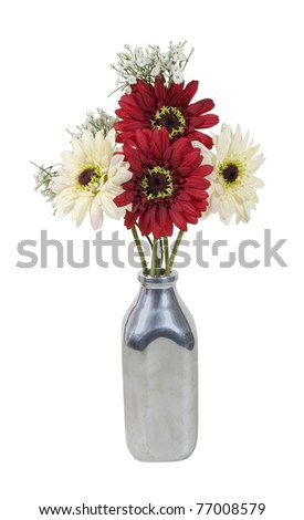 Silk flowers in a retro style silver milk bottle used for delivering milk - path included - stock photo