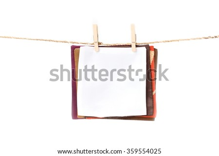 Silk Label note on clothes line with clothes pin, isolate on white background