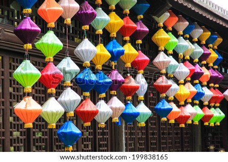 Silk lanterns decorations in the middle of the city in Hoi An, Vietnam - stock photo