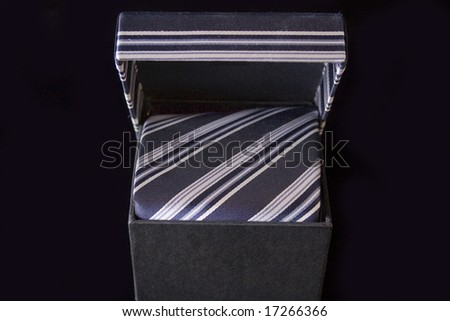 Silk necktie with box, isolated on the black background