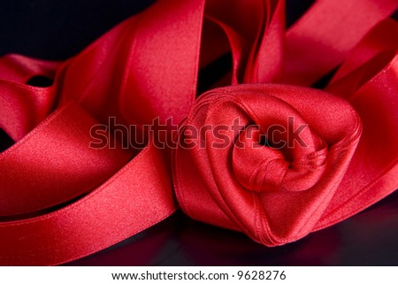 silk red rose on the black background - stock photo