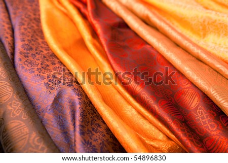 Silk scarves from India in a marketplace. - stock photo