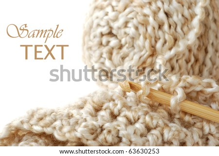 Silky textured yarn with bamboo crochet hook and detail of completed stitches.  Macro with shallow dof and copy space. - stock photo