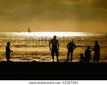 sillouette people on the beach