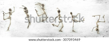 Silly dancing medical skeletons on grunge vintage background - stock photo